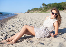 Beautiful girl on a beach. Beautiful girl in sunglasses on a beach. Outdoor shoot Royalty Free Stock Photos
