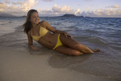 Beautiful girl at the beach. At sunrise in hawaii Stock Photography