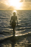 Beautiful girl at the beach. At sunrise in hawaii Stock Images