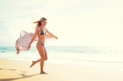 Beautiful girl on the beach at sunset Stock Photos