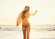 Beautiful girl on the beach at sunset Royalty Free Stock Photo