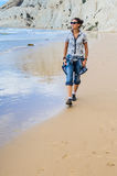 Beautiful girl on the beach Stock Images