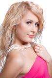 Beautiful girl with beads. Studio shot Stock Image