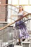 Beautiful girl in beautiful dresses on the stairs. Shooting outdoors Royalty Free Stock Photography