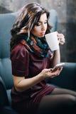 Beautiful girl with beautiful makeup drinking tea Royalty Free Stock Photography