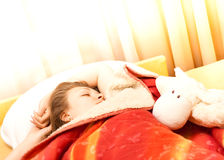 Beautiful girl in a bed Stock Photos