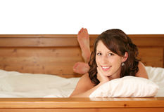 Beautiful girl in bed Royalty Free Stock Photos