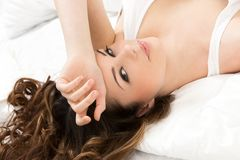 Beautiful girl in the bed Stock Photos