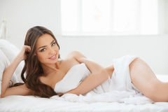 Beautiful girl in bed. Beautiful young women lying on the sofa a Stock Images