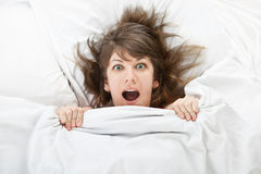 Beautiful girl in bed at home Stock Images