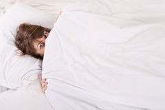 Beautiful girl in bed at home Stock Photos