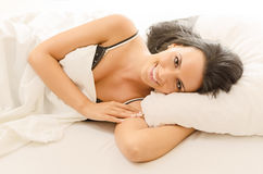 Beautiful girl in bed stock photos