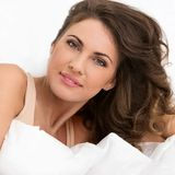 Beautiful girl in the bed Royalty Free Stock Photos