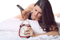 Girl ready to break the alarm clock Royalty Free Stock Photo