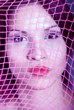 Beautiful girl behind the net. Portrait of beautiful girl behind the net stock image