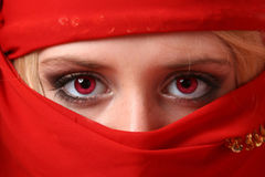 Beautiful girl behind an red scarf Stock Images