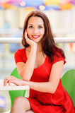 Beautiful girl behind table Royalty Free Stock Images
