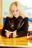 Beautiful girl behind table Royalty Free Stock Photos