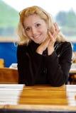 Beautiful girl behind table Stock Photos