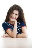 Beautiful girl behind table Royalty Free Stock Photography