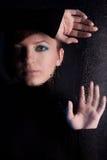 Beautiful girl behind wet glass Stock Photos
