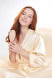 Beautiful girl in a beige smock Stock Photos