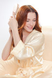 Beautiful girl in a beige smock Royalty Free Stock Photo