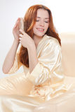 Beautiful girl in a beige smock Stock Images