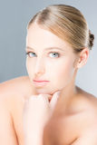 Beautiful girl is being applied with cosmetics Stock Photography