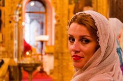 Beautiful girl believer in the church Royalty Free Stock Images