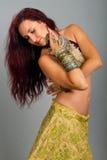 Beautiful girl belly dance movemen Stock Photos