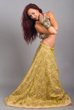 Beautiful girl belly dance movement Royalty Free Stock Photos