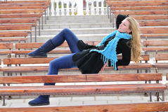 The beautiful girl on a bench Royalty Free Stock Image
