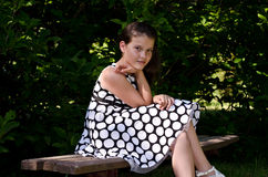 Beautiful girl on a bench in the park Royalty Free Stock Photos
