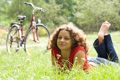 Beautiful girl with a bicycle Stock Photography