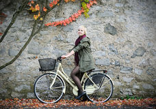 Beautiful girl with bicycle Royalty Free Stock Image