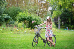 Beautiful girl with bicycle in the countryside Royalty Free Stock Images