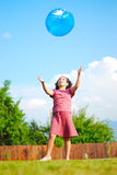 Beautiful girl with big ball on beautiful meadow Stock Images