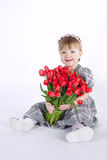 Beautiful girl with big bouquet of tulips royalty free stock photos