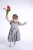 Beautiful girl with big bouquet of tulips Royalty Free Stock Photo