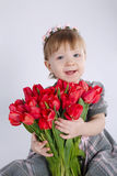 Beautiful girl with big bouquet of tulips Stock Photos