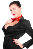 A beautiful girl with a big breast isolated. A beautiful gril in a black anderwear with a red bow on her neck (isolated on white royalty free stock photo