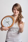 Beautiful girl with a big clock. In his hands Royalty Free Stock Photos