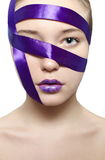 Beautiful girl big eyes in purple blue tape Royalty Free Stock Photos