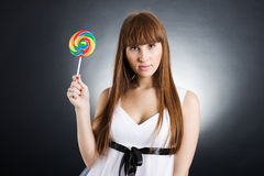Beautiful girl with big lollipop Stock Images
