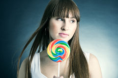 Beautiful girl with big lollipop Stock Photos