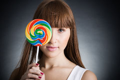 Beautiful girl with big lollipop stock image