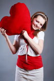 Beautiful girl with big red heart Royalty Free Stock Image