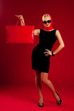 Beautiful girl with big red shopping bag. Studio royalty free stock photos