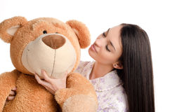 Beautiful girl with a big teddy bear. Stock Photos